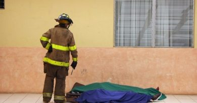 """Handout picture released by Guatemalan Volunteer Firefighters showing a firefighter looking to the corpses of two of the 20 victims of a fire at children's shelter Virgen de la Asuncion facility, in San Jose Pinula, about 10 kilometres east of Guatemala City, on March 8, 2017.  At least 20 teenage girls died in a fire at a children's shelter in Guatemala, a spokesman for the local fire service said. It was not immediately known how many of the bodies were those of children. The center, supervised by state social welfare authorities, hosts minors who are victims of family mistreatment. The facility has been the target of multiple complaints alleging abuse, and several children have run away. / AFP PHOTO / Guatemalan Volunteer Firefighters / HO / RESTRICTED TO EDITORIAL USE - MANDATORY CREDIT """"AFP PHOTO /Guatemalan Volunteer Firefighters /HO """" - NO MARKETING - NO ADVERTISING CAMPAIGNS - DISTRIBUTED AS A SERVICE TO CLIENTS"""